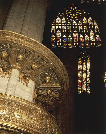 Italy - Lombardy region - Milan. Cathedral, southern pulpit and glass window with prophets and saints round the risen Christ : Stock Photo