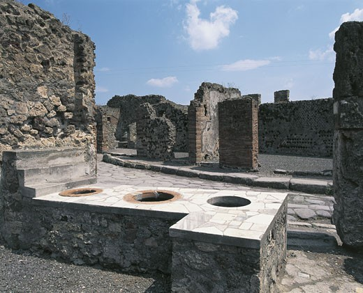 Ruins of an inn, Vicolo Del Lupanare, Pompeii, Campania, Italy : Stock Photo