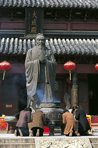 Stock Photo: 1788-9625 China - Jiangsu - Nanjing. The Confucius Temple (Fuzimiao). Believers praying in front of Confucius statue