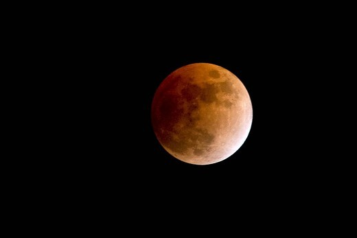Canada, Quebec Province, Montreal, total moon eclipse in the evening of Febuary 20, 2008, moon eclipsed completly : Stock Photo