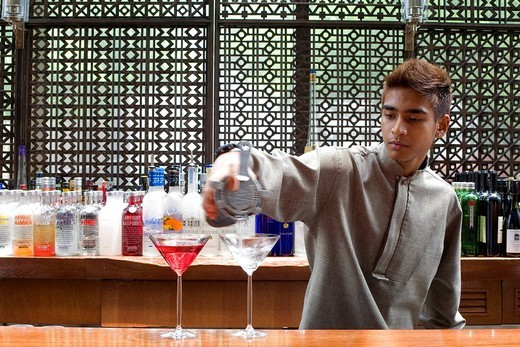 Stock Photo: 1792-102560 Singapore, Grand Hyatt, bartender at Martini bar at mezza9