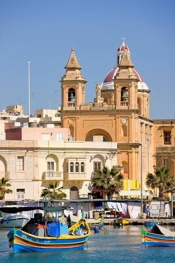 Malta, South Coast, Marsaxlokk, Our Lady of Pompeii church and the harbour : Stock Photo