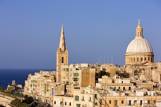 Malta, Valletta listed as World Heritage by the UNESCO, the Carmelite Our Lady of Carmel Mount church, and the Anglican church on the right : Stock Photo