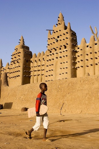Mali, Mopti Region, Djenne, listed as World Heritage by UNESCO, child going o the Koranic school with Koran verse written into his tablet : Stock Photo