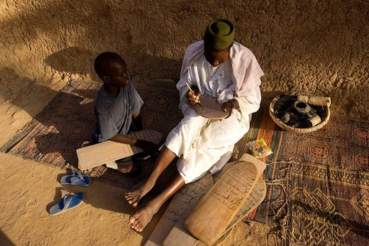 Mali, Mopti Region, Djenne, listed as World Heritage by UNESCO, Koran study, a student watching at his teacher writting a verse into a tablet : Stock Photo