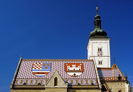 Croatia, Zagreb, 13th and 14th centuries St. Mark Church, Croatia arms on roof with polychrome glazed tiles on the right : Stock Photo