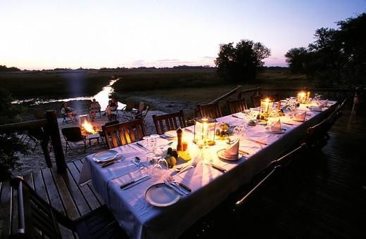 Stock Photo: 1792-109112 Botswana, North_West District, Kalahari Desert, Okavango Delta, Kanana Camp at dusk