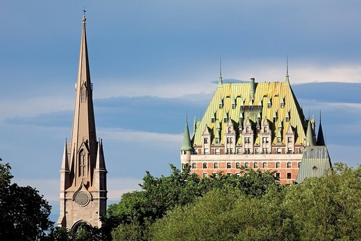Stock Photo: 1792-112268 Canada, Quebec Province, Quebec City, bell tower of the United Church of Canada, parish of St Pierre and Chalmers Wesley, Chateau Frontenac in the background