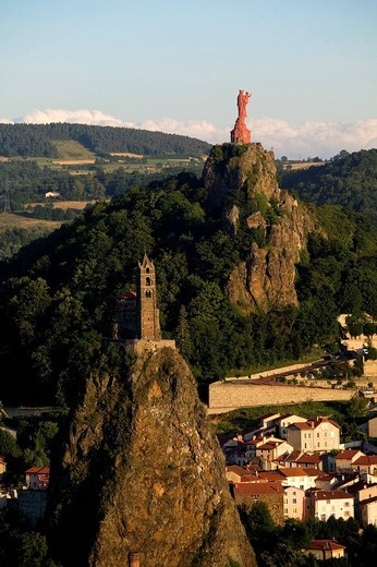 France, Haute Loire, Le Puy en Velay listed as World Heritage by UNESCO, the town is a stopover along the pilgrims´ route to Santiago de Compostela, St Michel d´Aiguilhe Rock in the foreground : Stock Photo