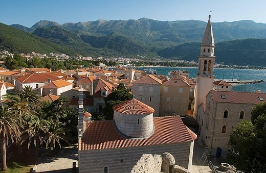 Montenegro, Adriatic Coast, old town of Budva, Budva, 19th century Catholic Church of the Holy Trinity and bell tower of Sveti Ivan Church on the coast : Stock Photo
