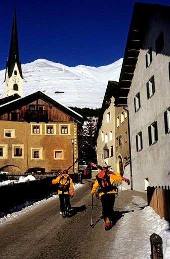 Stock Photo: 1792-117340 Switzerland, Graubünden, Zuoz, Skiers mountaineering after the run at village of Zuoz