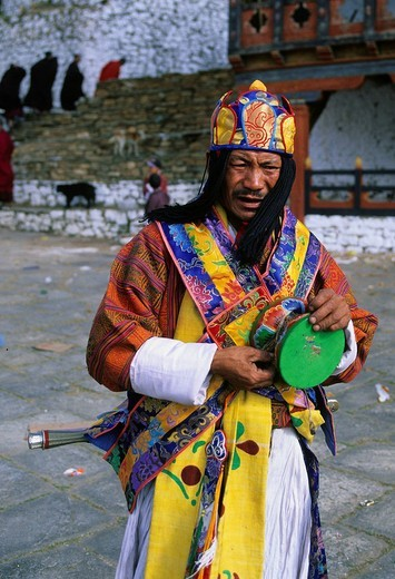 Stock Photo: 1792-118383 Bhutan, Paro District, Rinpung Dzong Buddhist fortress and monastery, Tsechu Annual Buddhist Festival, Shaman with a prayer drum, main figure of the ceremony