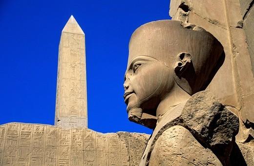 Egypt, Upper Egypt, Upper Egypt, Nile Valley, Luxor, Karnak listed as World Heritage by UNESCO, temple dedicated to Amon God, obelisk and Tutankhamun statue : Stock Photo