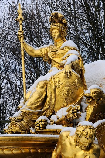 France, Yvelines, snow covered park of the Chateau de Versailles, listed as World Heritage by UNESCO, detail of a statue of the Triumphal Arch Grove : Stock Photo