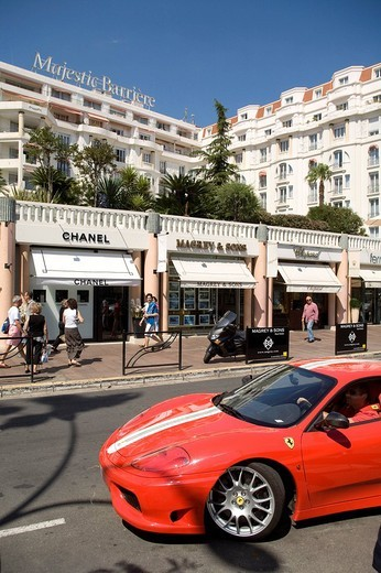 Stock Photo: 1792-120078 France, Alpes Maritimes, Cannes, Majestic Hotel, Barriere Group, view of croisette and ferrari in front fashion shop Chanel