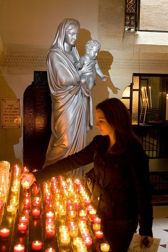 Stock Photo: 1792-120527 France, Bouches du Rhone, Marseille, candle in front of the virgin and child at the entrance of the crypt which opens up under Notre Dame de la Garde Basilica