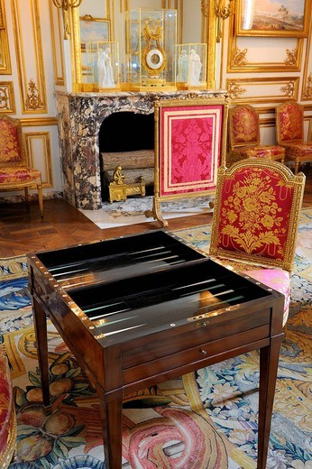 France, Yvelines, Chateau de Versailles, listed as World Heritage by UNESCO, the King´s Private Apartment, King Louis XVI´s rec room, tric trac table old game similar to the Backgammon : Stock Photo