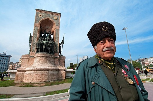 Turkey, Istanbul, Taksim Square, veteran in front of the Republican monument of 1928 dedicated to Ataturk and to the Independance heroes : Stock Photo