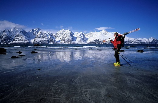 Stock Photo: 1792-124019 Norway, Troms County, Lyngen Alps, Ski touring on the beach after going down skiing at the level of the sea
