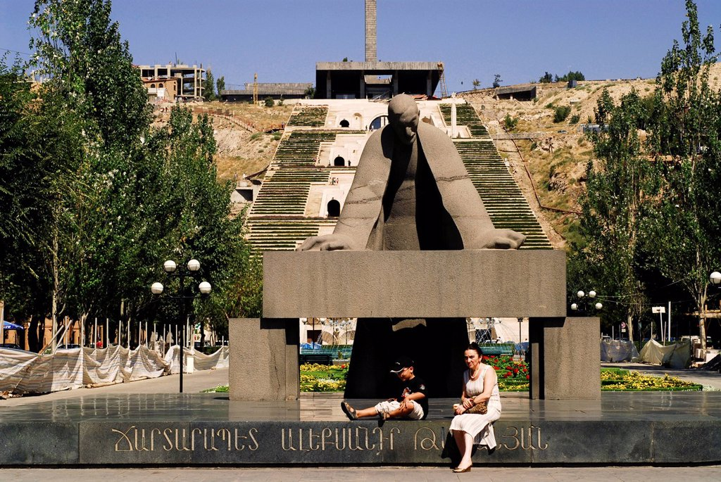 Stock Photo: 1792-126368 Yerevan, Armenia, Mother and child sitting at the bottom of Cascades, massive white steps that ascend from downtown Yerevan towards Haghtanak Park Victory Park.