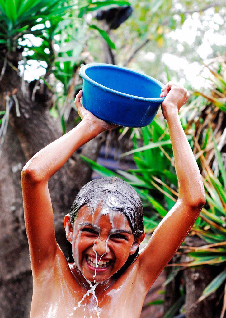 Guatemala, Los Achiotes, teenager Odalis Arcely Rodriguez Lopez 11 years taking bath outside : Stock Photo