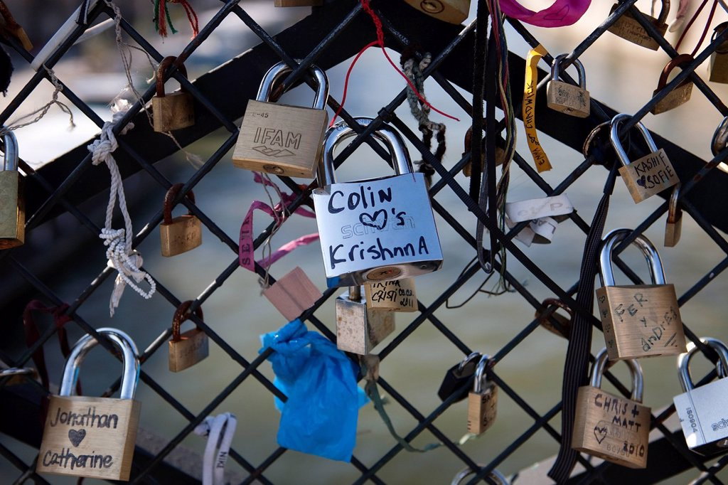 Stock Photo: 1792-128305 France, Paris, Archeveche bridge, padlocks hung by lovers on the railing