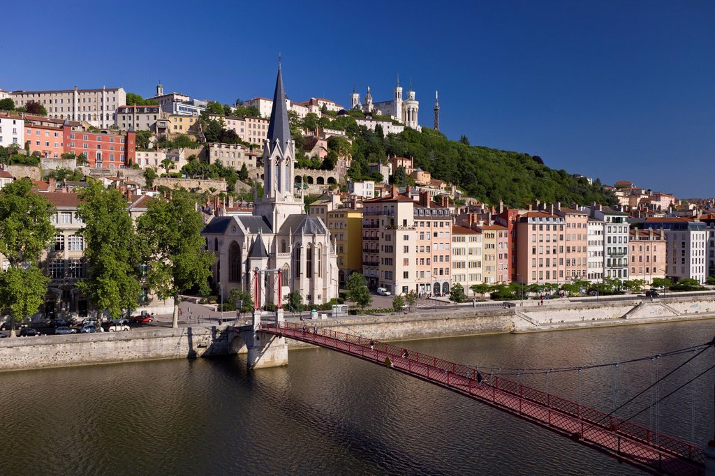 France, Rhone, Lyon, historical site listed as World Heritage by UNESCO, footbridge and St Georges Church over Saone River and Notre Dame de Fourviere Basilica : Stock Photo