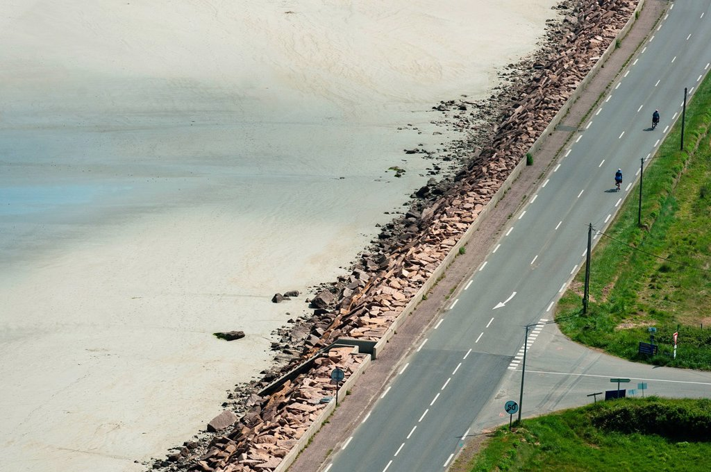 France, Cotes d´Armor, Plestin les Greves, cyclists on the coastal road along the shore of St. Michel : Stock Photo