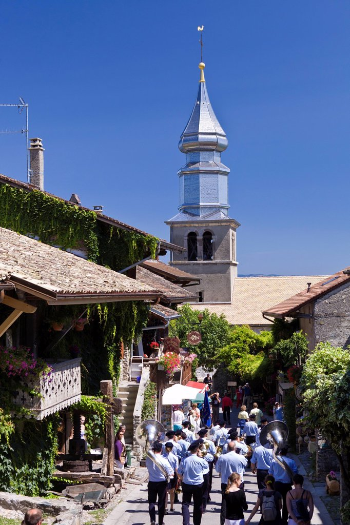France, Haute Savoie, Le Chablais, Yvoire, labeled Les Plus Beaux Villages de France the Most Beautiful Villages of France, the brass band and the onion dome of the church, built at the end of the 19th century, dedicated to Saint Pancras : Stock Photo