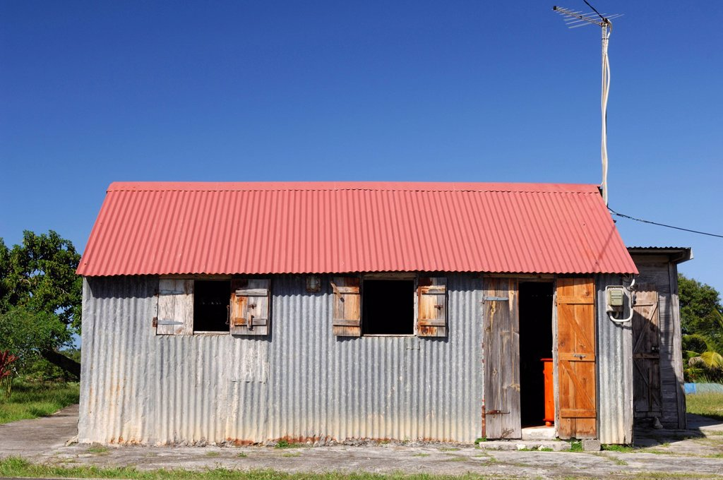 France, Guadeloupe French West Indies, Ile de Marie Galante, North coast, corrugated iron house : Stock Photo