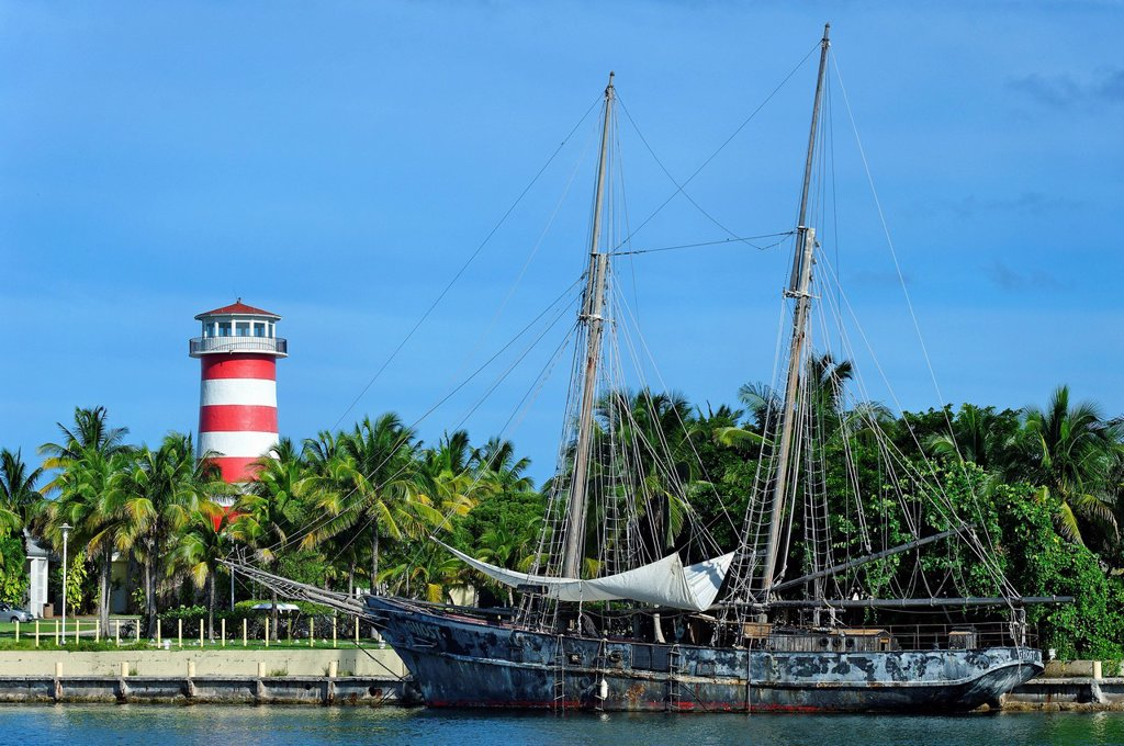 Stock Photo: 1792-134440 Bahamas, Grand Bahama Island, Freeport, Port Lucaya, Ghost, boat of Pirates of the Caribbean movie with lighthouse in background