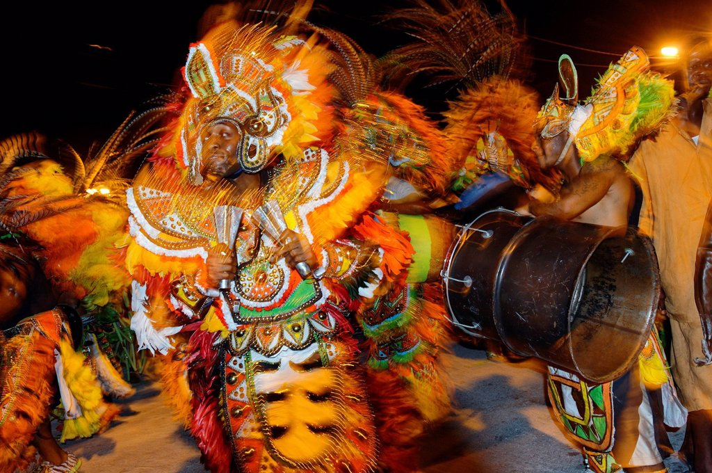 Bahamas, Grand Bahama Island, Freeport, Taino Beach, summer carnival, resumption of famous Junkanoo celebration slaves established on the island since the 17th century, percussionists with their feathered costumes and masks during a parade : Stock Photo