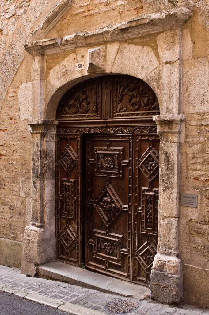 France, Lot, Cahors, old door detail of the seventeenth century, the castle of King Street : Stock Photo