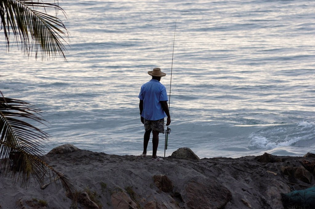 Stock Photo: 1792-137641 France, Martinique French West Indies, Grand Riviere, fisherman and his fishing rod along the Caribbean Sea