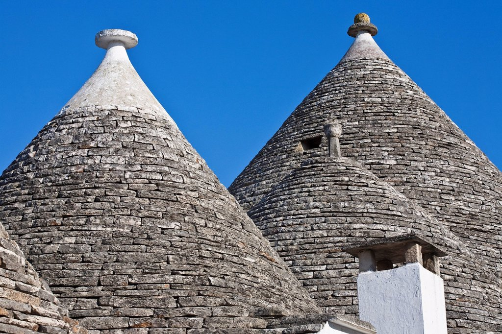 Stock Photo: 1792-138000 Italy, Puglia, Bari province, Alberobello, trulli borrough old dry stone buildings with slate roof, listed as Wolrd Heritage by UNESCO