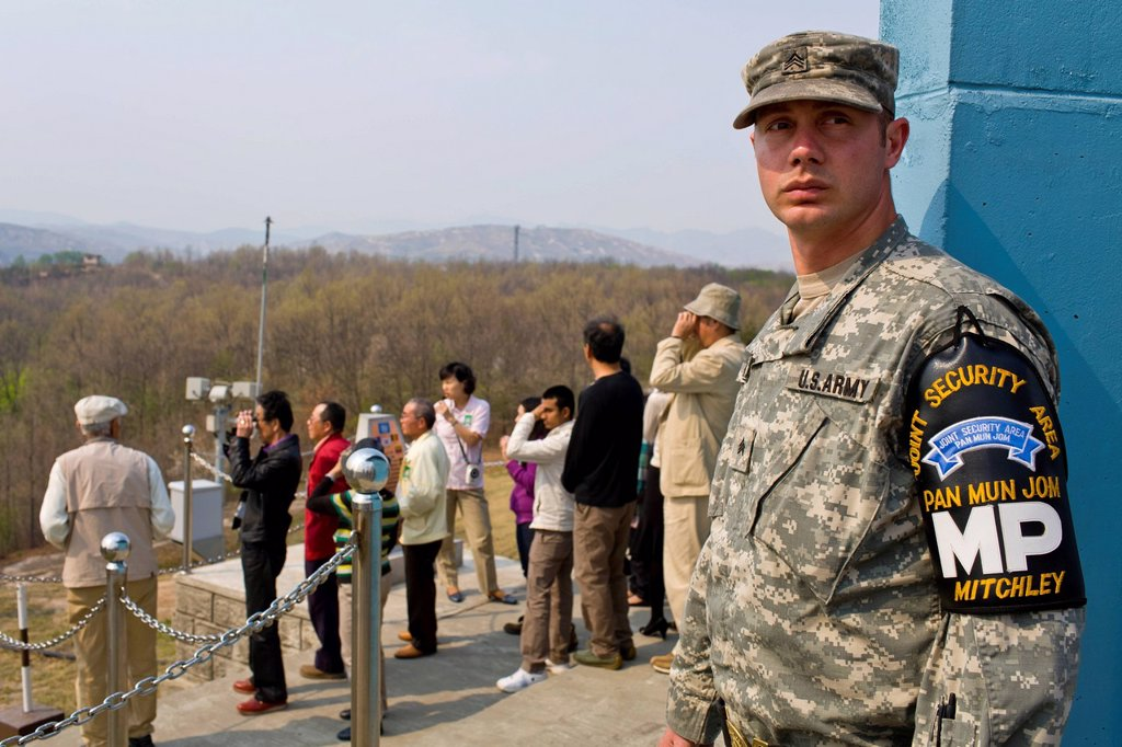 South Korea, Gyeonggi Province, Panmunjom, Joint Security Area JSA, American soldier guiding tourists around JSA : Stock Photo