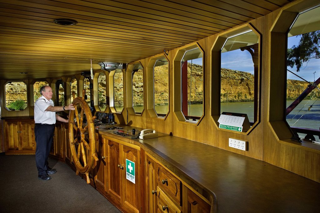 Stock Photo: 1792-139235 Australia, South Australia, Murray River, Murray Princess paddle boat near Big Bend Cliff, captain Ray Weedon in the wheelhouse
