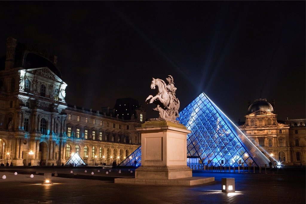 France, Paris, the Louvre Pyramid by the architect Ieoh Ming Pei at night : Stock Photo