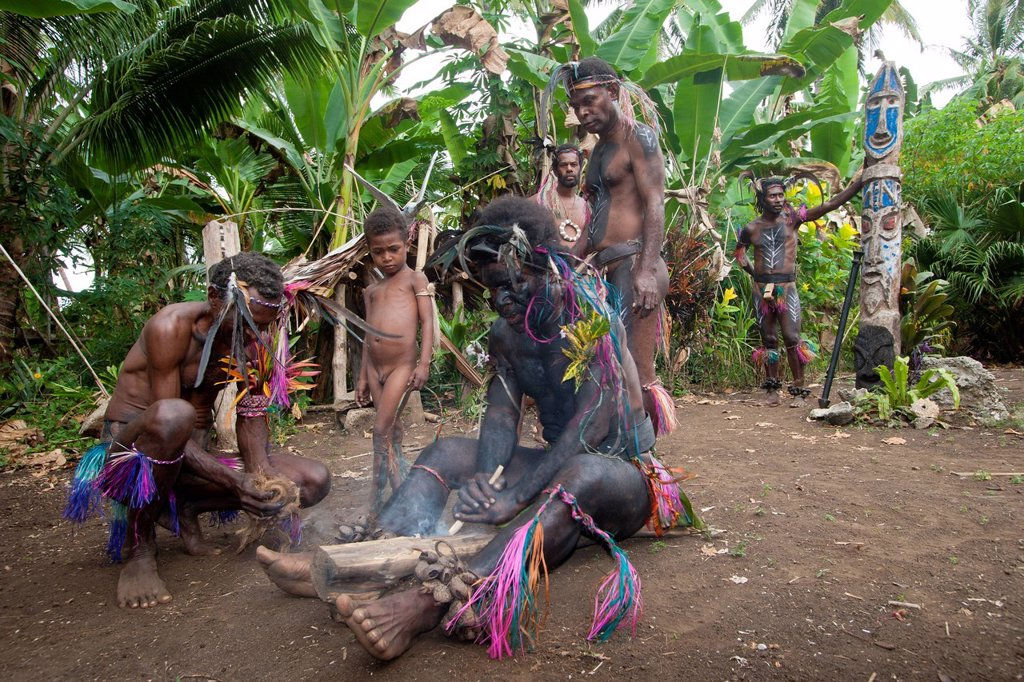 Stock Photo: 1792-152230 Vanuatu, Malampa Province, Malekula Island, Gortiengser, Small Namba shaman making fire by rubbing two wooden elements, fire plow technique