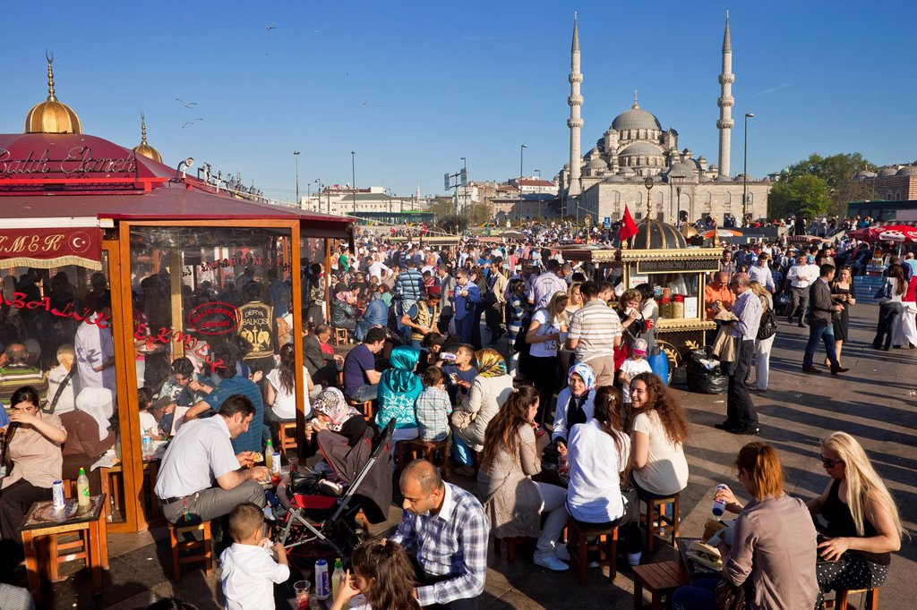 Turkey, Istanbul, historical centre listed as World Heritage by UNESCO, Eminn district, fish restaurants on boats and the Yeni Cami New Mosque in the background : Stock Photo