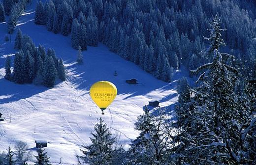 Switzerland, region of Bern (Bernese Oberland), Saanenland, hot-air balloon over Gstaad´s valley : Stock Photo