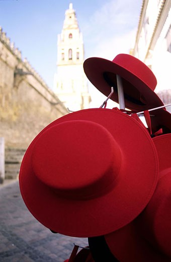 Spain, Andalusia, Cordoba, display of Andalusian hats with the Mezquita in the background : Stock Photo