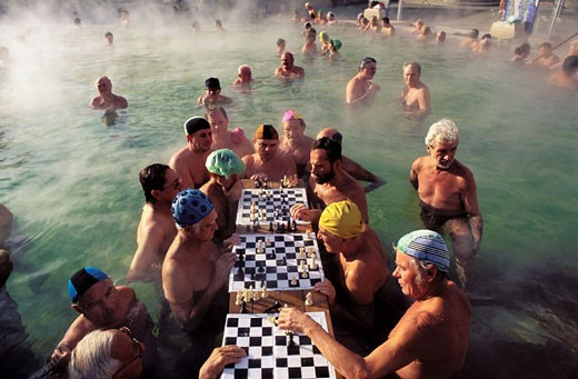 Hungary, Budapest, chess players in the famous Szechenyi baths at Pest : Stock Photo