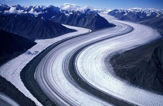Canada, Yukon, Kluane National Park, flight in helicopter above the Kaskawulsh glacier : Stock Photo