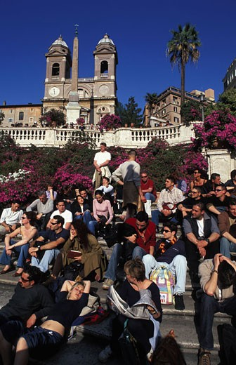 Italy, Latium, Rome, Piazza di spagna, tourists on the stairs of the church of the Holy Trinity dei Monti : Stock Photo