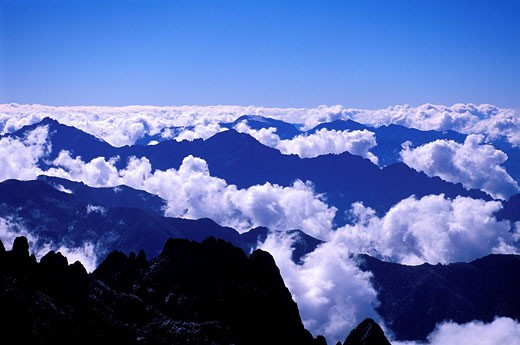 France, Haute Corse, Corsican Mountains appearing from Clouds aerial view : Stock Photo