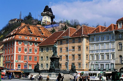 Austria, Styria state, Graz, city, the Hauptplatz (central square) the Archduke John statue and the Tower Bell : Stock Photo