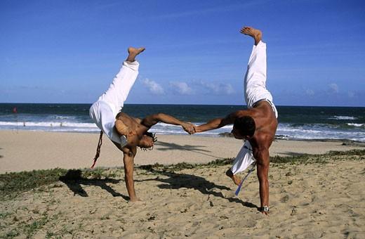 Brazil, Bahia state, capoeira demonstration on the beach : Stock Photo
