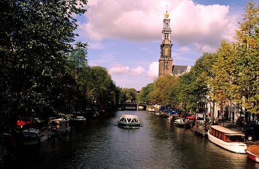 Netherlands, Northern Holland Province, Amsterdam, Jordaan District, Prinsengracht, Westerkerk bell-tower in the background : Stock Photo