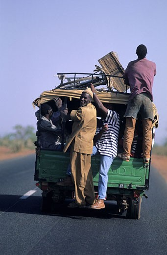 Mali, overloaded van on the road : Stock Photo
